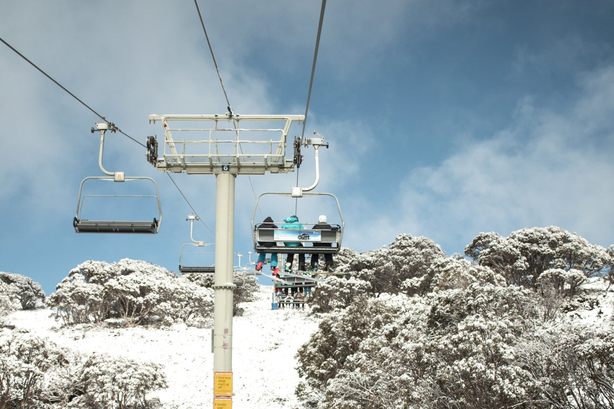 Chair lifts up snowy mountain